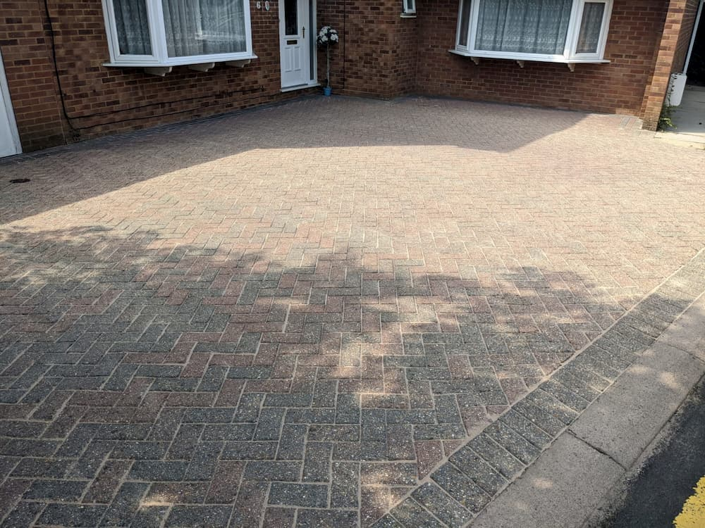 clean block paved driveway